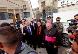 Cardinal Emmanuel III Delly, at the site of the October 31 attack [© Associated Press]
