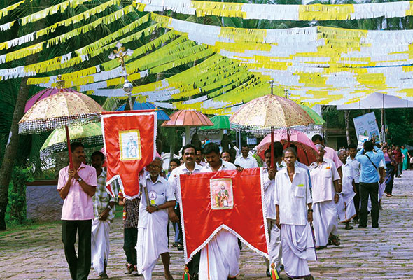 A procession on the occasion of 'dukhrana', the commemoration of St Thomas, near the Church of St Thomas, in Palayur, in the State of Kerala