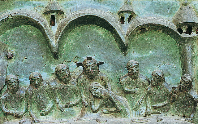 Detail from the Last Supper, panel on the 10th century portal of the church of San Zeno, Verona