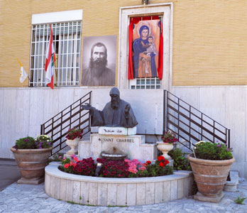 The entrance to the monastery of the Lebanese Maronite Order with the statue of St Charbel Makhlouf canonized in 1977 by Pope Paul VI [© Paolo Galosi]