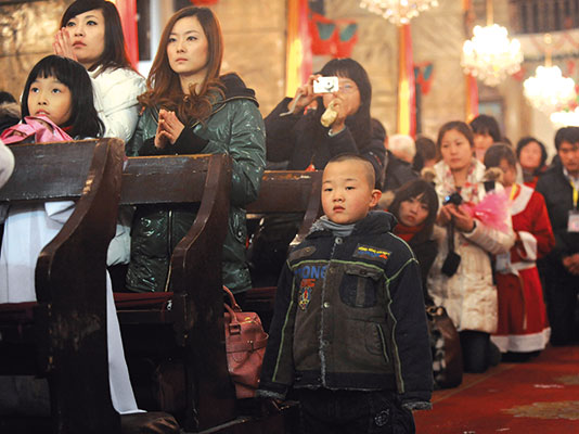 Faithful during Christmas Mass at a church in Beijing [© Getty Images]