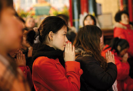 Chinese faithful in prayer in a Beijing church [ Getty Images]