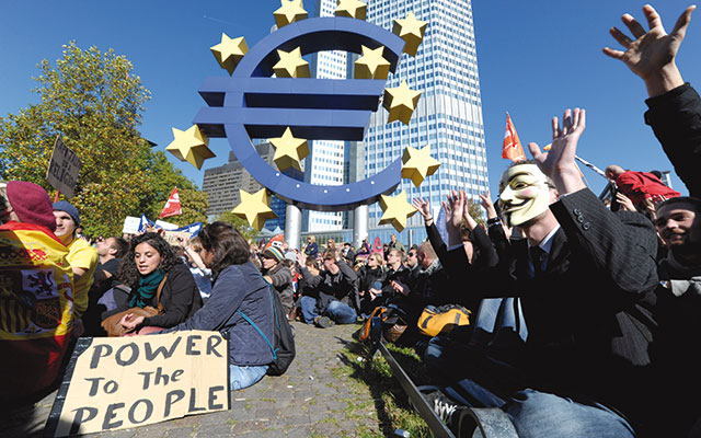 Protesters outside the headquarters of the European Central Bank in Frankfurt in October 2011 [© Associated Press/LaPresse]