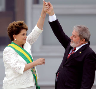 The outgoing Brazilian President Luiz Inácio Lula da Silva, raising the arm of President Dilma Rousseff at Planalto Palace, Brasilia, on 1 January 2011